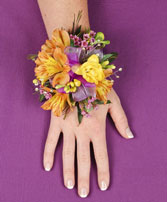 SPRINGTIME SUNSET Prom Corsage in Red Wing, MN | HALLSTROM'S FLORIST & GREENHOUSES