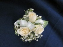 3 Rose Corsage Round Style, $25.00 Red, Yellow, Pink, Orange also available