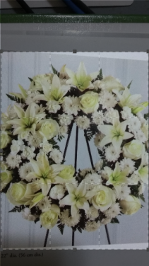 all white open wreath funeral flowers
