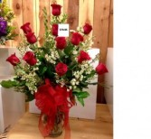 Any color dozen roses arranged in a vase Mothers Day