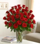 *I LOVE YOU THE MOST* 3 dozen long stem red or colored roses arranged in a vase