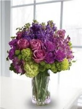 B 15-Mixed flower arrangement in a tall vase (Flowers and colors may vary)