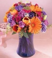 JB 14-Mixed flower arrangement in a tall vase (flowers and colors may vary)