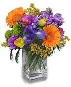 GW 4-Mixed flowers in a compact arrangement (Flowers and colors may vary)