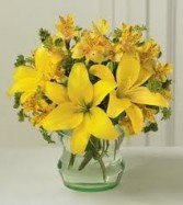 JB 12-Mixed flowers in a compact arrangement (Flowers and colors may vary)