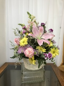 Mom's Garden Basket All Around Arrangement.  Colors may vary. in Berwick, LA | TOWN & COUNTRY FLORIST & GIFTS, INC.