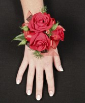 PUTTING ON THE RITZ RED Prom Corsage in Bath, NY | VAN SCOTER FLORISTS