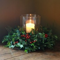Rose hips and candle lite Christmas Arrangement