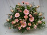 Funeral arrangement in pretty shades of pinks... roses, carnations, gerbera daisies, altra lillies, etc.