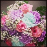 wedding arrangments  round soft colors in blues lavenders and whites