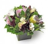 TA-4- Tropical flowers in a compact arrangement Flowers and colors may vary