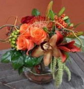 TA-14 Tropical flowers in a compact arrangement Flowers and colors may vary