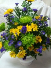 Sympathy arrangement in greens, purples and yellow