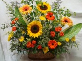 Beautiful arrangement of oranges, yellows, and greens in a nice keepsake Tin container.