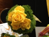 Yellow roses and green trick carnations hand tied bouquet