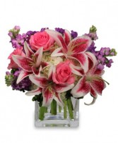 MORE THAN WORDS...<br/>Flower Arrangement Star Gazer Lilies, Purple Stock, Pink Rose Flowers in a cube